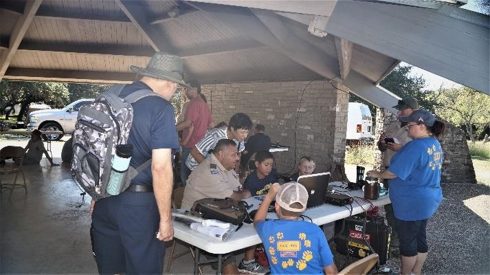 Rosendo Guzman, N5YBG, working with some Scouts and their parents at JOTA