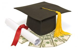 Mortar board, diploma and money.  Image